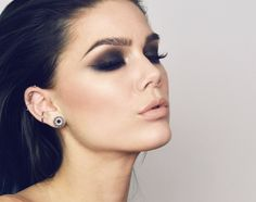 Dark brown smokey eyes, with a touch of sparkle.