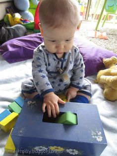 Empty tissue box with various blocks. Cut out the bottom of the box so the child can do the activity over himself.
