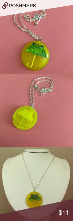 """Puddle Jumper Neon Resin Frog Umbrella Necklace 💕Puddle Jumper necklace previously made for my Etsy shop 💕Resin pendant filled with neon yellow glitter and a frog umbrella! 💕Comes with a necklace similar to the one pictured depending on which I have in stock. 💕Measures about 20"""" long total. Piece is 1.5"""" across and tall.  ‼️Price is FIRM as this is a handmade item and takes about a week to make, as each of the resin layers is poured separately and takes time to cure. NO trades‼️ Ritzee…"""