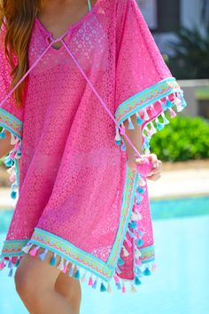 Bright coloured, tassel trend beach cover up!