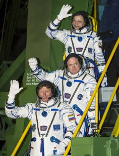 NASA Image of the Day | NASA Expedition 43 Russian cosmonaut Mikhail Kornienko of the Russian Federal Space Agency (Roscosmos), top, NASA astronaut Scott Kelly, center, and Russian cosmonaut Gennady Padalka of Roscosmos wave farewell as they board the Soyuz TMA-16M spacecraft