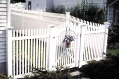 """Vinyl 48"""" arched Chestnut Hill signature gate butting into a southport privacy fence with transition section #fence #fencing #yard #backyard #outdoor #home #house #landscape #landscaping"""