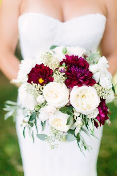 roses, dahlias and peonies in shades of ivory and burgundy...this with pine and turqoise mixed in somehow?