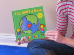 Earth Day book and sorting recyclables