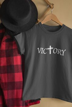 Wear this shirt to proclaim his victory. Through the cross there is victory. Choose from different colors and sizes and buy now at our store. #christian clothing #friends T-shirts # Christian tees #faiths shirts #faith and fashion #Christian apparel # Christian fashion Christian Clothing, Christian Shirts, Christian Apparel, Victorious, Sayings, Sweatshirts, Sweaters, T Shirt, Stuff To Buy