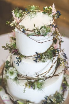 Rustic buttercream, flowers and willow wedding cake.