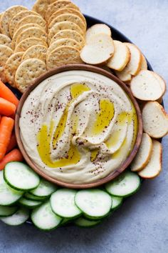Roasted Garlic Hummus with Feta - Learn how to make the smoothest hummus ever with just a simple trick! #roastedgarlic #roastedgarlichummus #hummus | Littlespicejar.com