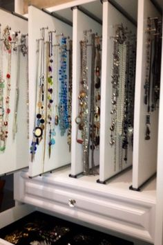 Pull-out boards on sliders for hanging necklaces, bracelets and earrings!
