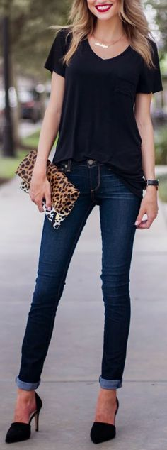 Love the casual black tee with rolled up dark denim jeans and heels. Fun for a night out or to dress down with black flats.