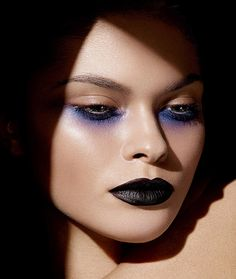 Cool gothic glam makeup with purple eyeshadow under the lash lines + black lips
