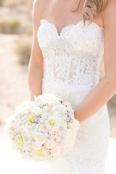 White Bouquet with Pops of Blush and Antique Brooches | Brides.com