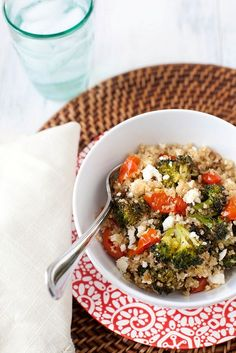 Quinoa salad with roasted tomatoes, broccoli and feta (broccoli, feta, grape tomatoes, quinoa, vegetable stock).
