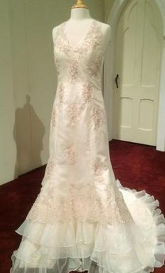 Other Custom Designed in Las Vegas 12: buy this dress for a fraction of the salon price on PreOwnedWeddingDresses.com