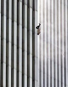 a great photo doesn't show what it looks like, a great photo shows what it FEELS like. This is one of those photos that, to me, completely captures 9/11. I remember seeing it in the paper the first time and I bawled my eyes out seeing it. It's still so powerful and that is why I love photography...it is so powerful.
