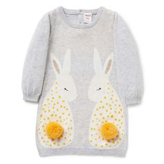 100% Cotton. Fully fashioned long sleeve dress features front placement bunny intarsia with attached pom pom tails. Regular fitting silhouette with 1 x 1 rib trims on neckline, cuffs and hem. Available in Cloud.