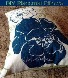 Make your own throw pillows out of place mats!!