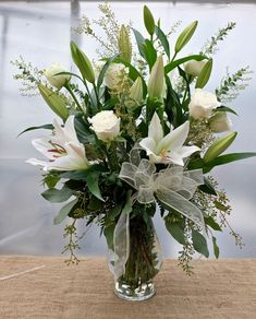 A garden floral vase designed with elegant and fresh white roses and lilies and unique foliage. Funeral Floral Arrangements, Easter Flower Arrangements, Rose Arrangements, Flower Centerpieces, Flower Vases, Flower Pots, Funeral Bouquet, Funeral Flowers, White Roses