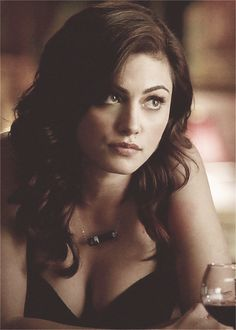 """[Phoebe Tonkin] """"Hey, I'm Annabelle but I prefer Anna. I'm twenty years old and I'm a widow. I'm only here to watch over and protect my younger siblings. I get drunk a lot and I'm very careless with my life but no one cares so it's fine."""" I sigh """"I'm a brown wolf and I have this big white spot on my face when I shift."""""""