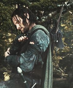 One of my favorite moments is when Aragorn puts on Boromir's bracers. It's small moments like this that really show Aragorn's emotional depth. Many heroes are so busy being heroic that they aren't very human, but the sorrow and sincerity he felt at Boromir and Gandalf's losses are prime examples of his true, kingly nature.