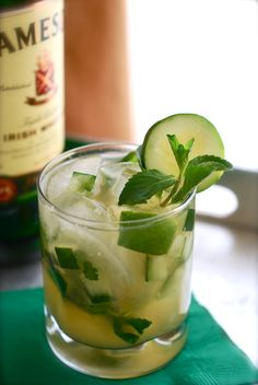 Green Whiskey Smash: 1/2 lime, cut into small wedges 1/4 cup diced cucumber 5 sprigs fresh mint, plus more for garnish Ice 2 ounces whiskey 4 ounces cold limeade