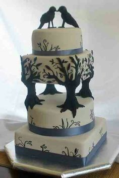 Black & white, tree pillar wedding cake with crow cake toppers. Pic - cakepicturegallery.com (unfortunately I couldn't see a credit for the cake maker).
