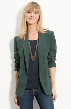 Beautiful green blazer with jeans and  navy blue t-shirt.  Elegant casual look