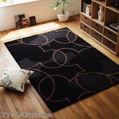 Black cotton rug, stencil and bleach solution....
