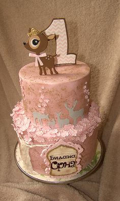 """Children's Birthday Cakes - This is the cake I made for my daughter's first birthday. I wanted it to be sweet and gentle like she is. The letters of her name are written in cyrillic which I achieved by using standard letter cutters and then cutting parts of them and fitting them into desired shapes. Her name Srna means """"a female deer"""", so there is a whole deer family on the cake. A little doe on top is replica taken from her first baby suit she got before she was born. It indicated her name…"""