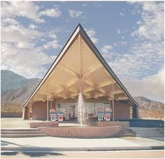 "Gas station in Palm Springs designed by Albert Frey in 1963, photographed by Julius Shulman. This distinctive, modern structure with its ""hyperbolic paraboloid canopy"" (try saying that five times fast) closed for business in the mid 90's and has since been resurrected as the Palm Springs Visitors Center."