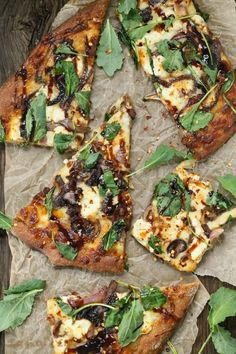 Ccaramelized onion kale goat cheese pizza with balsamic drizzle. Made with whole wheat pizza dough.