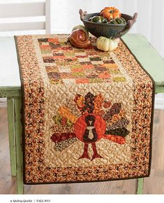 Let's Talk Turkey table topper quilt! This quilted table topper digital pattern from Fons & Porter's Quilting Quickly Fall 2013 issue will inspire you and your guests to gobble up your feast so there's more time to talk turkey. Great quilt project for holiday quilts and fall quilts!