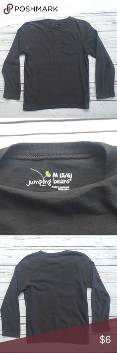 "Jumping Beans dark gray henley shirt Jumping Beans dark gray henley shirt in excellent pre-owned condition with no stains, minimal wash wear.    Size M (5/6)    Measurements are approximate:  armpit to armpit: 15""  shoulder to hem: 18 3/4""  shoulder to cuff: 17""    B1 Jumping Beans Shirts & Tops"