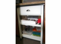 Our inking/stamping/embossing station is a pantry/utility cart that fits under the counter.  The drawer holds embossing powders, ink pads, embossing tools, and various other tools.  The shelves hold various stamps and inking items.  The cart rolls out easily to add an additional work surface.