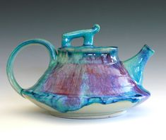 This Etsy shop has beautiful teapots and other pottery.  Mika, New Moon Teapot, Ceramic Teapot, ceramics and pottery. via Etsy.