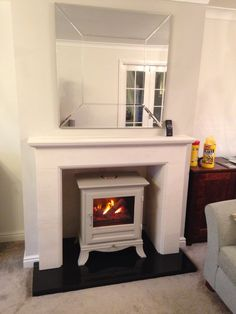 Chesneys electric stove and limestone fireplace fitted by colesforfires.co.uk