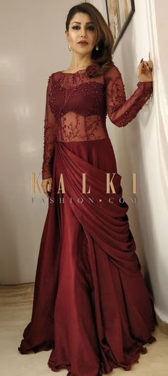 Wine gown in net will gain you tons of compliments at the reception party. The gown flaunts the embroidered net fabric with fancy satin flare. Net Gowns, Drape Gowns, Navy Bridesmaid Dresses, Bridal Dresses, Designer Gowns, Indian Designer Wear, Latest Gown Design, Gown Party Wear, Simple Gowns