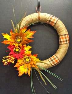 Faux Fall 2014 Season Burlap wrapped Foam wreath with Autumnal Burlap Sunflowers, Leaves and burlap ribbon accents. Original Design and Arrangement by http://nfmdesign.synthasite.com/
