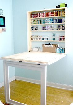 compact home activity center with fold up table and storage for small spaces--ok- now THIS is an AWESOME school work/bill pay/craft workstation!! and when folded up, it becomes a framed cabinet!!