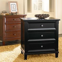 Relaxed traditional styling in two finish options. This nightstand features 3 drawers.  Available in Antique Black or Cherry