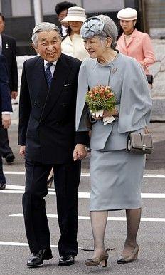 Japan's Emperor Akihito (L) and Empress Michiko, Tokyo's Haneda Airport May 16…