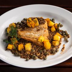 Roasted black cod with black lentils, fried potato cubes, capers and ...