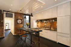 Elegant kitchen with a lovely brick wall backsplash [Design: Bennett Frank McCarthy Architects] - Decoist