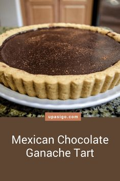 Recipe: Spicy Mexican Hot-Chocolate Ganache Tart from upasigo.com #upasigo #recipe #chocolate #chocolatelovers #chocolatechip #yummy #tarte #tart #chocolatetart #cinnamon #cayenne #chili #spicy #sweet #sweetandspicy #spicyandsweet #indulgent #delicious #shortbread #shortbreadcookie #shortbreadcrust #ganache #chocolateganache #chocolatecake Chocolate Chili, Mexican Hot Chocolate, Like Chocolate, Tart Recipes, Dessert Recipes, Desserts, Shortbread Cookie Crust, Chocolate Ganache Tart, Ganache Recipe