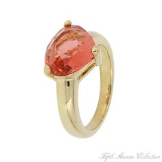 """The stunning beauty of a sun drenched summer rose, the colour of fine sparkling wine is captured in this romantic ring. The latest cut and colour found in this beautiful cubic zirconia is selected to be the rage of the coming fashion season. Finished in gold, """"Crackling Rose"""" is the perfect accessory to add extra sensation to your style!"""