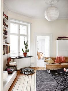 Open and bright living room space #livingroom #livingroomideas #livingroomdecor #livingroomfurniture #livingroomlayout #couch #sofa #pillows #bookshelf