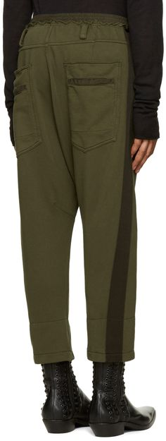 Slim-fit French terry lounge pants in khaki. Cropped fit. Raw edge at waist…