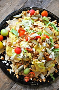 """Vegan Cheeseburger Nachos – Rabbit and Wolves Vegan Cheeseburger Nachos – Tofu """"ground beef"""", quick vegan nacho cheese sauce, lettuce, tomatoes, onion and pickles. the best nachos ever! Veggie Recipes, Mexican Food Recipes, Vegetarian Recipes, Healthy Recipes, Vegetarian Dinners, Lunch Recipes, Quesadillas, Burritos, Enchiladas"""