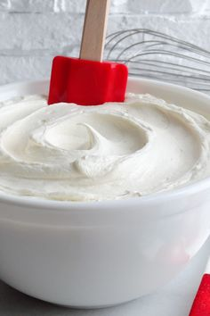 White Chocolate Cream Cheese Buttercream Frosting ~ This special frosting is full of buttery flavor and is creamy, light and fluffy. Just the right amount of butter, cream cheese and white chocolate is used to create a buttercream that not only pipes beautifully, but has the texture of mousse and tastes just like White Chocolate Cheesecake!   cake filling frosting recipe