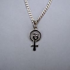 The Silver Feminist Symbol made by J & M Jewellers