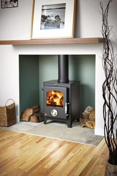 Newton wood burning stoves are stunning contemporary stoves that ooze character. With an elegant design, high efficiency, these stoves are rated – Models are finished with beautifully crafted stainless steel door and seamless primary air control. Log Burner Living Room, Living Room With Fireplace, New Living Room, Home And Living, Living Room Decor, Living Room With Stove, Fireplace Facing, Wood Burner Fireplace, Home Fireplace